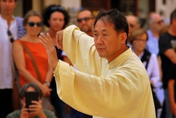 Image of man doing Tai Chi